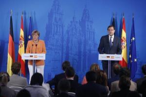 El presidente del Gobierno español junto a la canciller alemana en su comparecencia de hoy / Foto: @PPopular